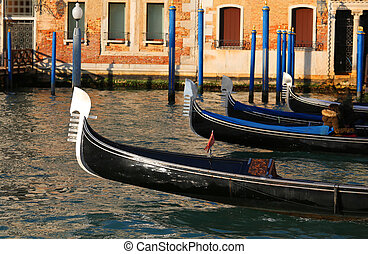 gondolas sailing the waters of the Grand Canal in Venice Italy
