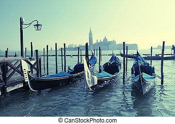 Gondolas, Saint Mark square,Venezia, Italy - Gondolas moored...