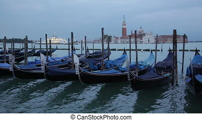 Gondolas shake on water the Grand Canal, Venice