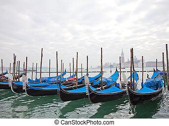 Gondolas with blue cover in Venice