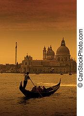 Gondolier in Venice, Italy - Gondolier at the dusk in Venice...