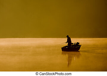 Gone Fishing - A single angler enjoys fishing from a boat on...