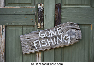 Gone Fishing - Gone fishing sign on door.
