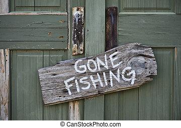 Gone fishing sign on door.