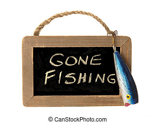 gone fishing written on small chalk board with a fishing lure attached