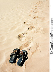 Gone for swim - Sandals on the beach