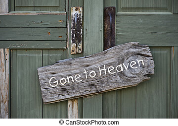 Gone to Heaven. - Old gone to heaven sign on doorway.