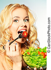 good appetite - Portrait of a beautiful young woman eating ...