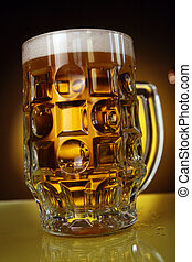 good beer glass on yellow background
