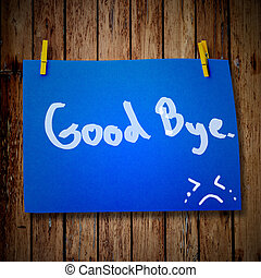 Good bye note paper and clothes peg on a wooden background...