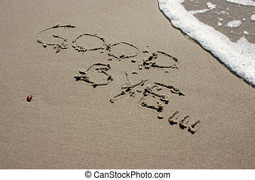 Good bye - Words good bye written on the beach sand