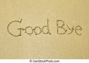 Good bye written in the sand at the beach