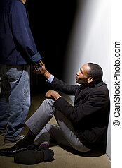 Good Deeds Helping Hand - man helping a depressed fellow by...
