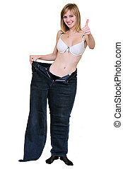 slim girl after diet in one leg of her old jeans