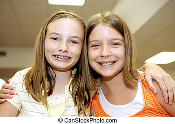 Good Friends in School - Two cute adolescent girls together...