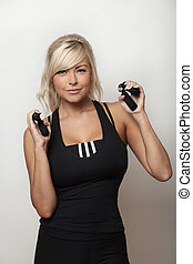 good grip - woman using hand grips in her work out