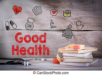 Good Health. Stack of books and a stethoscope on a wooden background