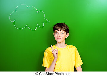 good idea - Smart schoolboy stands at the blackboard in the ...