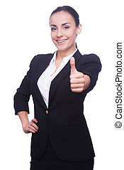 Good job! Happy young woman in formalwear showing her thumb up and smiling while standing isolated on white