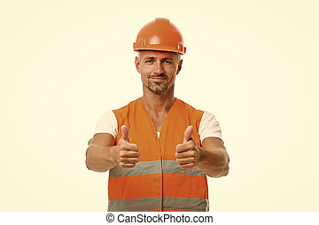 Good job. Safety is main point. Man builder wear protective hard hat and uniform white background. Worker builder confident looking camera. Protective equipment concept. Strong handsome builder