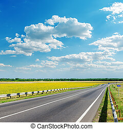 good landscape with asphalt road under clouds on sky