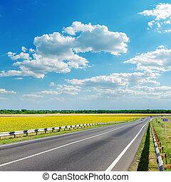 good landscape with asphalt road under clouds on sky