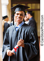 good looking afro american male graduate on graduation day