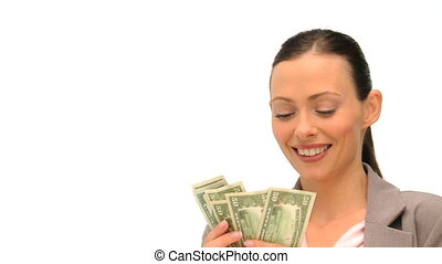 Good looking brunette holding her cash against a white background