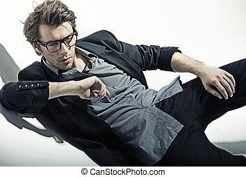 Good-looking brunette man lying on the floor - Good-looking...