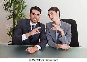 Good looking business people negotiating in a meeting room