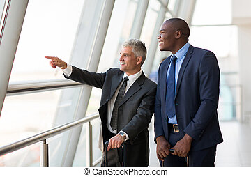 business travelers pointing at airport