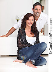 Good looking couple relaxing at home