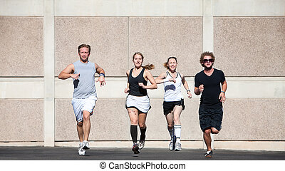 Good-looking couples out for a morning run.