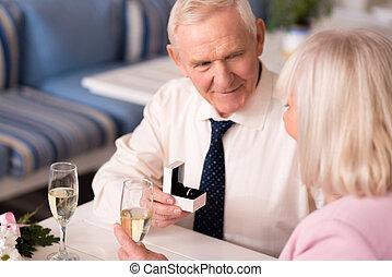 Good looking elderly man offering his hand