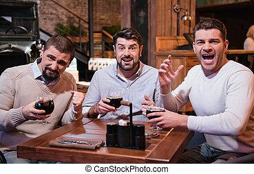Good looking emotional men watching sports games