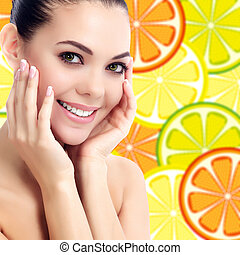 Good looking female on a background with orange slices
