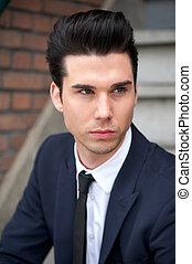 Good looking male fashion model in suit