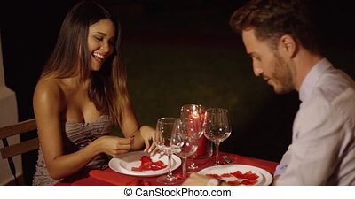 Good looking man makes joke and gestures at beautiful dinner...