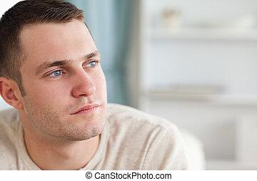 Good looking man posing in his living room
