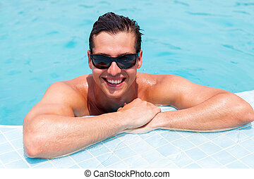 man relaxing in a swimming pool