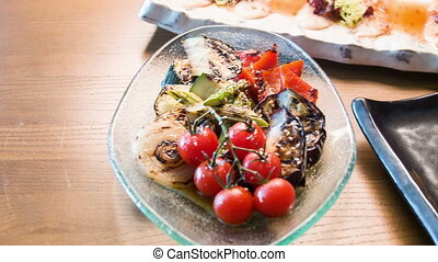 Horizontal dolly shot of appetizing grilled vegetables -...