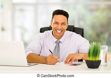 mid age business executive working in office
