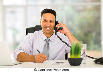 mid age businessman making phone call