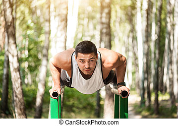 Good looking strong man doing push ups