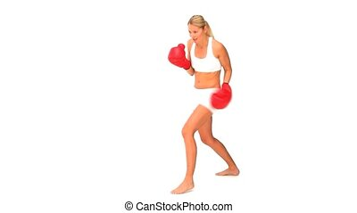 Good looking woman in sportswear with red boxing gloves...