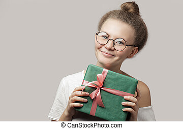 good-looking woman is going to give a present to a colleague