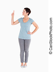 Good looking woman pointing at copy space