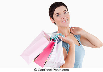 Good looking woman posing with shopping bags