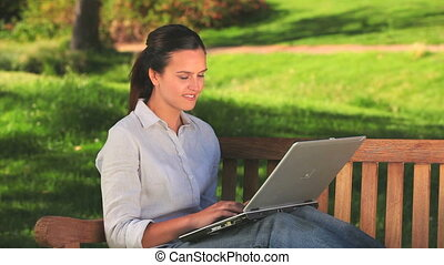 Good looking woman using a laptop - Good looking woman using...