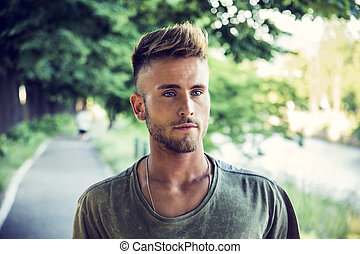 Good looking, young man relaxing in nature - Good looking,...